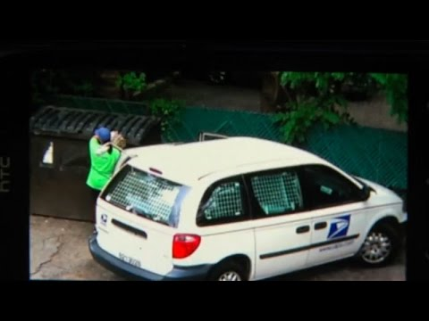 Postal worker delivers mail... to a dumpster