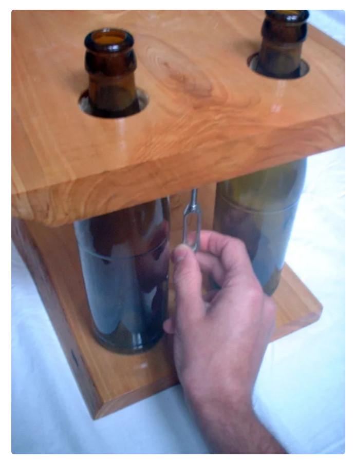 diy-modular-shelving-coffee-table-using-repurposed-wine-bottles