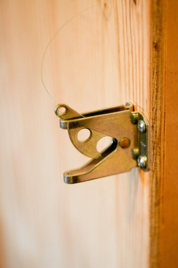 hidden bookshelf door latch lock