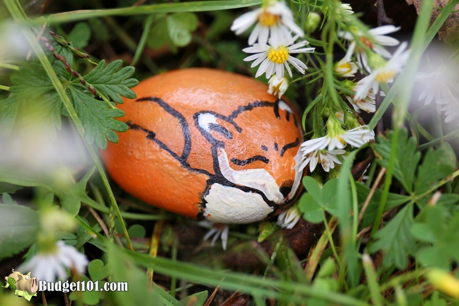 fox painted rock hidden in flowers