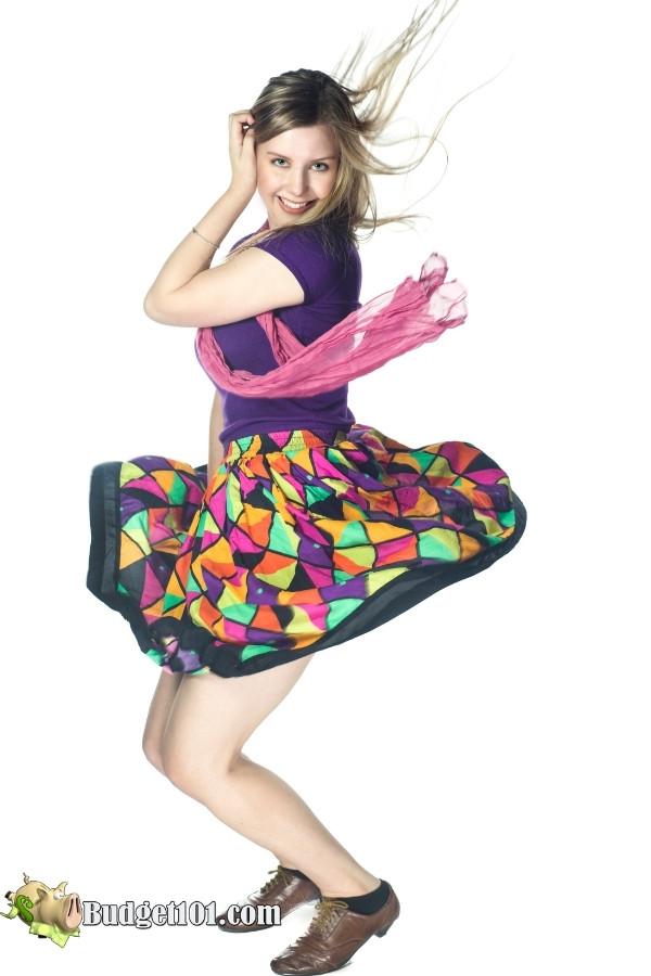 t shirt tucked high waisted skirt